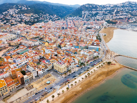 Aerial view of sand beach and city Roses, Catalonia