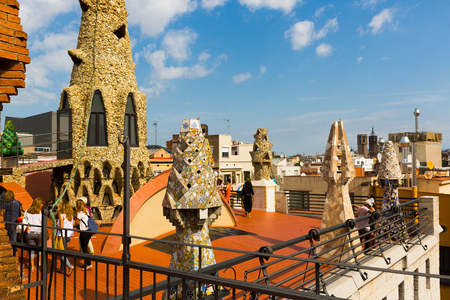 BARCELONA, SPAIN - SEPTEMBER 02, 2018: Palau Guell roof with chimneys turned by architect Antoni Gaudi into sculptures