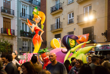 Valencia, Spain - March 18, 2019: Huge colorful dolls made of cardboard, paper-mache and polystyrene foam on streets of Valencia during annual Las Falles spring festival