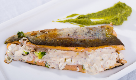 Delicious fried trout fillet with steamed broccoli and tartare sauce