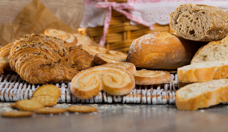 Image of various kinds of bread and  bakery products on table