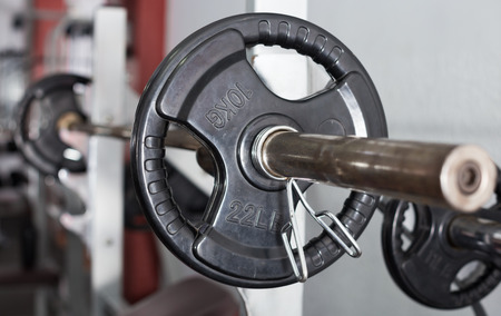 Closeup of weightlifting gear in modern gym interior