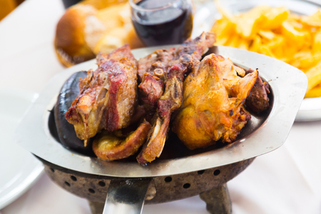 Popular Argentinian dish asado of grilled meats served at dinner Stock Photo