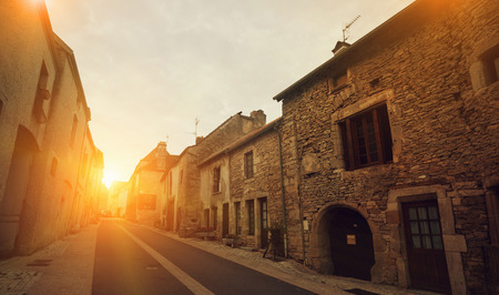 Summer view of Bligny-sur-Ouche narrow streets and stone houses, France