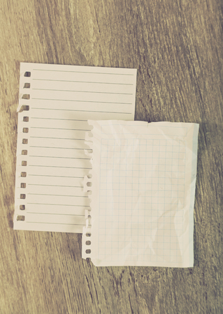 Torn sheets in notebook on table