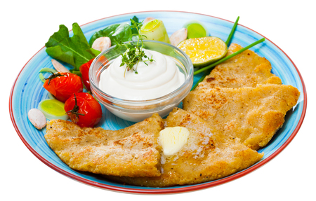 Delicious fried Tattie scones from mashed potatoes served with sour cream, vegetables and greens. Scottish cuisine. Isolated over white background