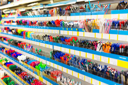 Image of shelves with a different pens and stationery in stationery shop