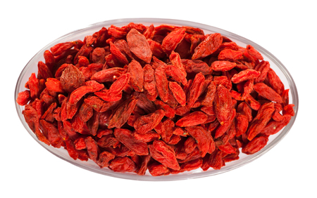 Background of red dried Goji berries. Isolated over white background Stock Photo