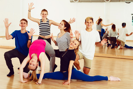 Portrait of  emotional teen  posing at dance  class