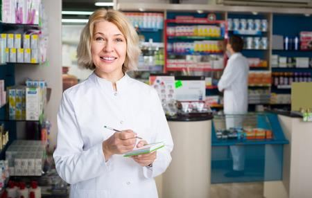Female technician working in chemist shop