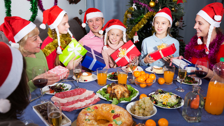Portrait of happy family who is satisfied of presents in time celebration New Year at home