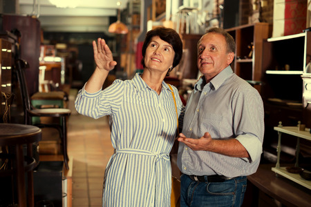 Adult couple is shopping in the antique store together