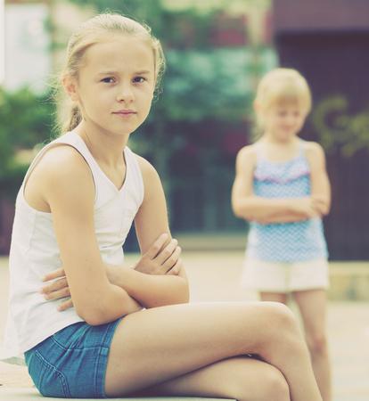 Two quarreled little girls having problems in relationship