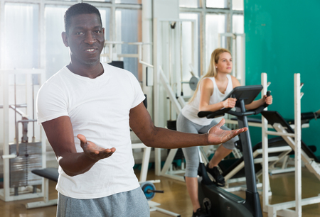 Portrait of adult african man in sportswear welcoming to sport club Stock Photo
