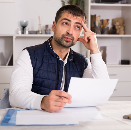 Distressed male having problems with paying utility bills and rent Stock fotó