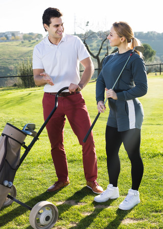 russian male and female golfers ready for team play at golf course Zdjęcie Seryjne