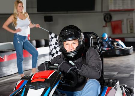 Portrait of glad man finishing race at kart circuit Фото со стока
