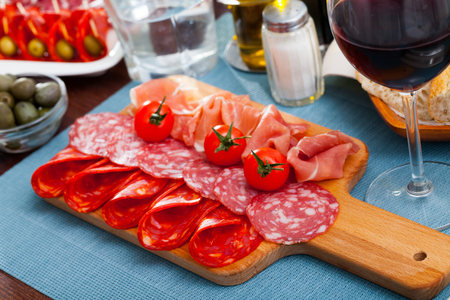 Coldcuts of delicious Spanish cured jamon and piquant sausages garnished with cherry tomatoes