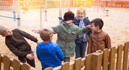 Children play in the blind mans buff