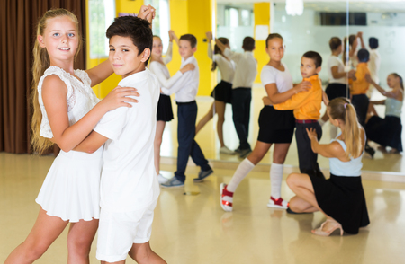 Active young children  enjoying of partner dance in class Stock fotó