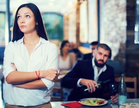 quarreled tired female and male in restaurant on celebrate Imagens