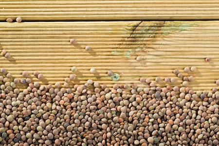 Lentil grains on a wooden surface