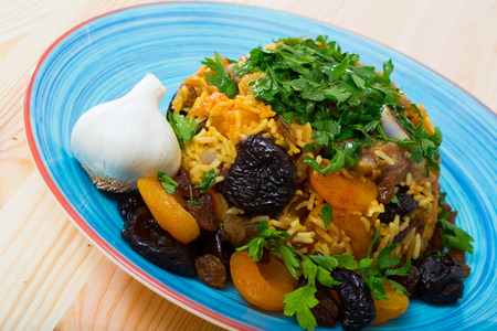 Delicious fragrant pilau with lamb, dried plums and apricots seasoned with saffron and garlic