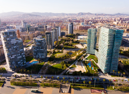 Panoramic aerial view of modern area of Diagonal Mar i el Front Maritim del Poblenou in coastal zone of Barcelona, Spain