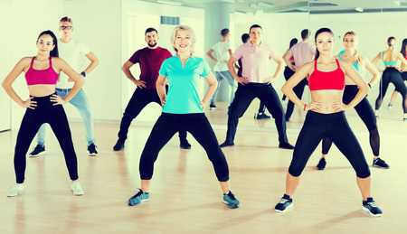 positive people dancing aerobics at lesson in the dance class