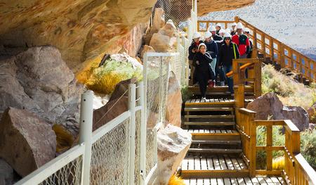 RIO PINTURAS, SANTA CRUZ, ARGENTINA - JANUARY 30, 2017: Excursion to caves with wall drawings and negative images of human hands and animals Cueva Las Manos (Cueva de las Manos del Rio Pinturas). Patagonia, Argentina, Santa Cruz