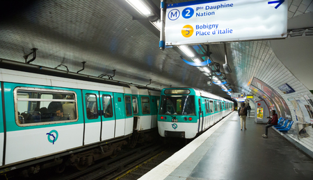 PARIS, FRANCE - OCTOBER 10, 2018:  People waiting train on platform of Paris metro station