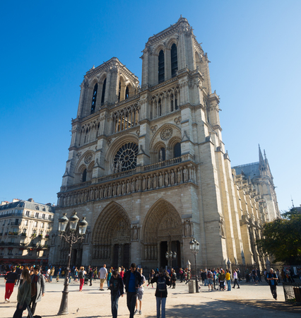 PARIS, FRANCE - October 10, 2018: Famous architectural and cultural landmark of France - Notre-Dame Cathedral on sunny day