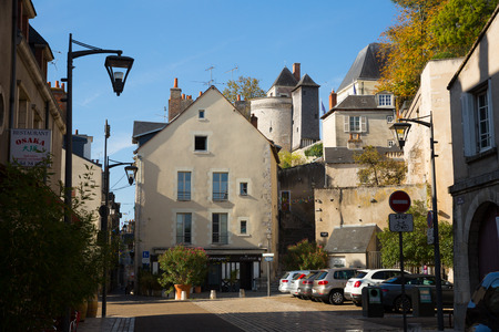 BLOIS, FRANCE - OCTOBER 09, 2018: Medieval old houses with parked cars on street of Blois city, France