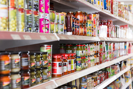BARCELONA, SPAIN - JUNE 4, 2018: Image of different  goods in cans at shelves  in the food store