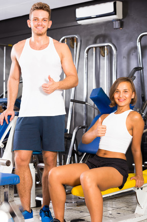 young positive man taking break during workout in gym indoors Stock Photo