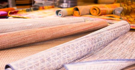 Image of wattled organic bamboo rugs at interior shop, no people