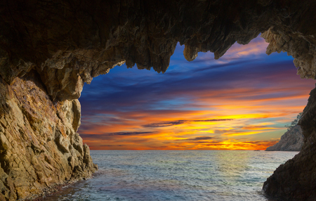Picturesque waterfront caves at Mediterranean coast in summer