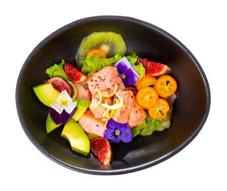 Delicious ceviche with salmon fillet, avocado, figs and kumquat. Isolated over white background
