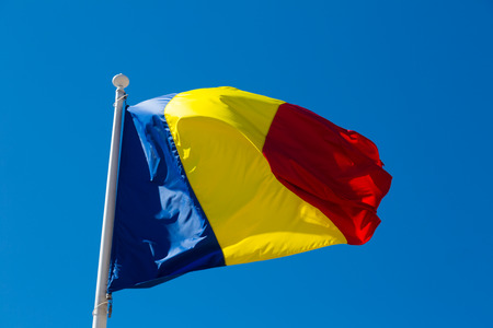Romanian flag is national symbol of country. Фото со стока