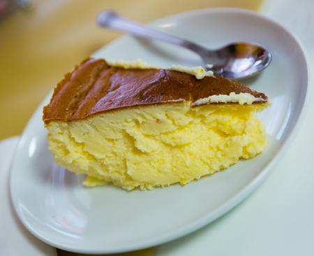 Slice of easy and tasty Tarta de queso cheesecake. Homemade baking Stock Photo