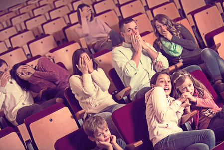 Group people attending movie night for horror in cinema Banque d'images