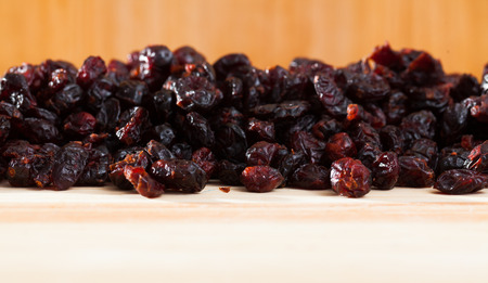 Dehydrated blueberries on wood surface. Natural food background Stock Photo