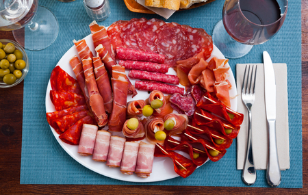Spanish sausage sliced - chorizo, fuet, jamon, salami, bacon