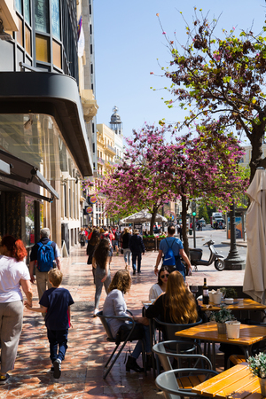 VALENCIA, SPAIN - APRIL 16, 2019: Lively central streets of Valencia city in sunny spring day Editorial