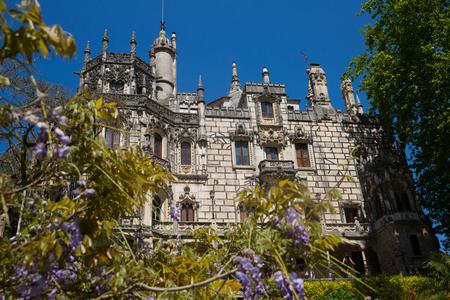 SINTRA, PORTUGAL - APRIL 21, 2019: View of main facade of impressive palace in Quinta da Regaleira