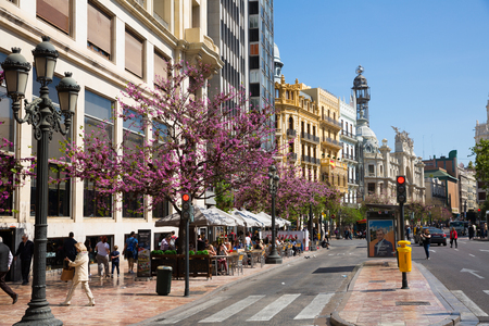 VALENCIA, SPAIN - APRIL 16, 2019: Spring view of houses of different architecture on one of central streets of Valencia Editorial