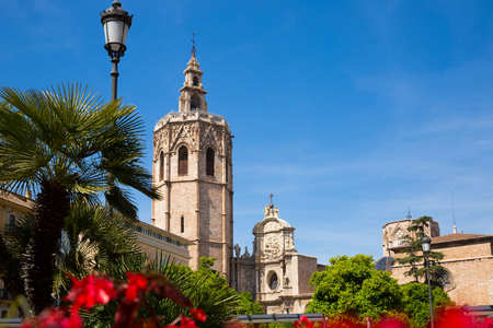 Picturesque view of Placa de la Reina and Cathedral with bell tower, Valencia, Spain