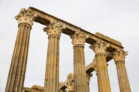 Closeup of decorative capitals of corinthian columns of ancient Roman Temple remnants in historic Evora, Portugal