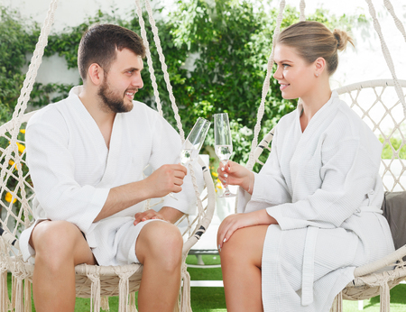 happy woman spending romantic day with husband outdoors in spa resort Standard-Bild - 123049236