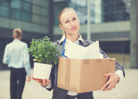 Businesswoman is standing happy near office because she leave bad job. Standard-Bild - 123049387